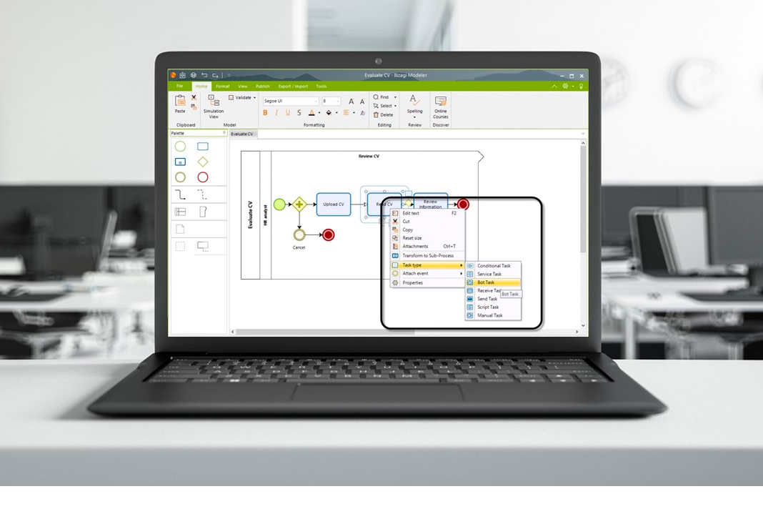 Robotic process automation integration interface in Bizagi Studio on laptop screen